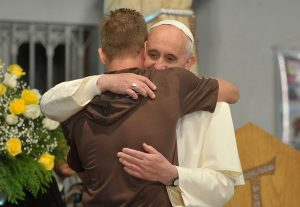 1024px-Pope_Francis_hugs_a_man_in_his_visit_to_a_rehab_hospital