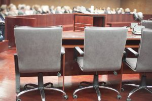 Pennsylvania Criminal Justice System | backs of chairs in a courtroom | Luongo Bellwoar LLP