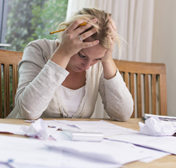 Bankruptcy Lawyer in Chester County PA | Woman Reviewing Financial Papers | Luongo Bellwoar LLP
